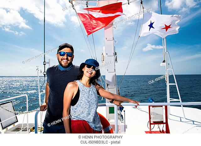 Couple enjoying dive boat trip, Tubbataha Reefs Natural Park, Sulu Sea, Philippines