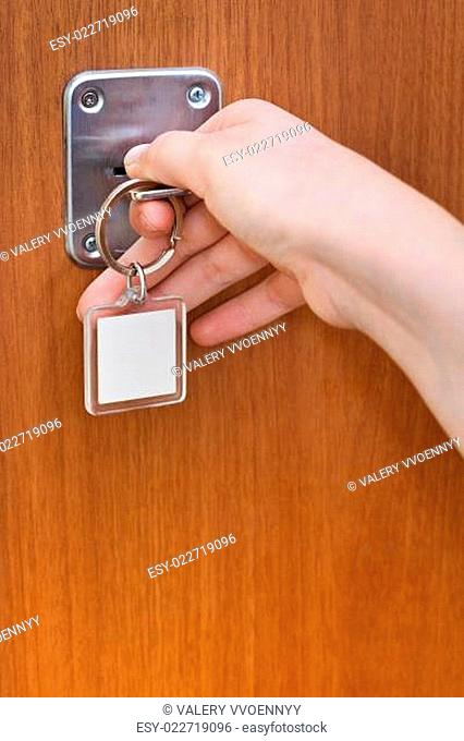 opening home door by key with blank keychain
