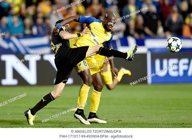 Dortmund's Marc Bartra (l) and Nicosia's Mickael Pote vie for the ball during the Champions League group stages qualification match between APOELNicosia and...