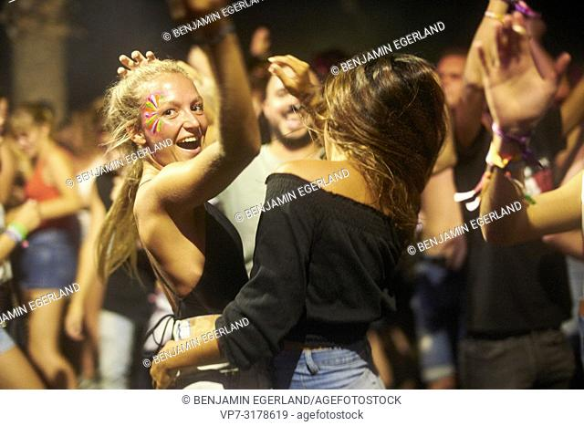 party girls dancing at music festival Starbeach Chersonissos, Crete, Greece
