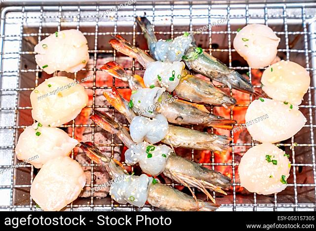 grilled japanese tiger prawn and hokkaido scallop yakiniku with red hot charcoal