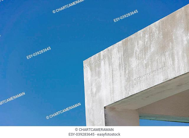 edge of concrete roof of building with blue sky