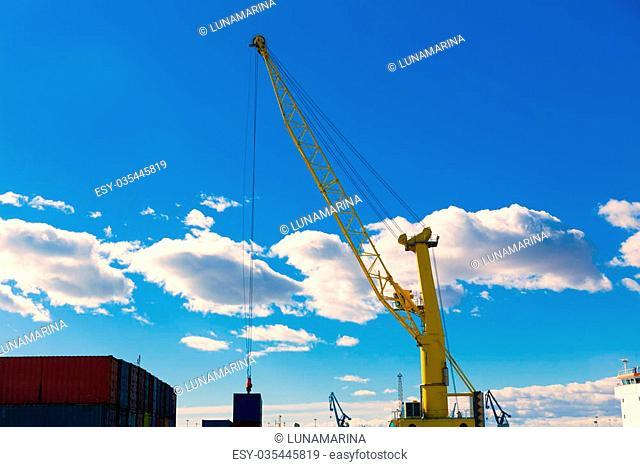 Sagunto port dock yellow crane in Valencia in a sunny day