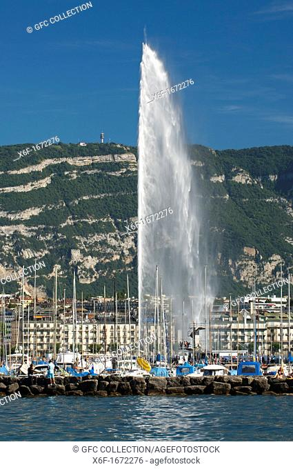 The monumental water fountain Jet d'Eau at the Lake Geneva lakefront in front of the Saleve mountain range in neighboring France, Geneva, Switzerland