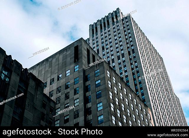 New York City - USA - DEC 17 2018: Underside panoramic and perspective view to facade fragment of Rockefeller Center building in midtown Manhattan