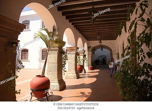 Arches and pots inside of a colonial building, Oaxaca, Oaxaca State Mexico, Central America