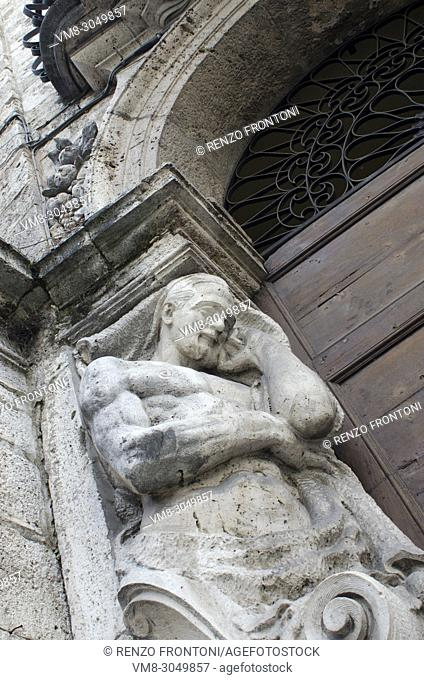 Male figure functioning as a supporting column on doorway, Ascoli Piceno, Marche, Italy