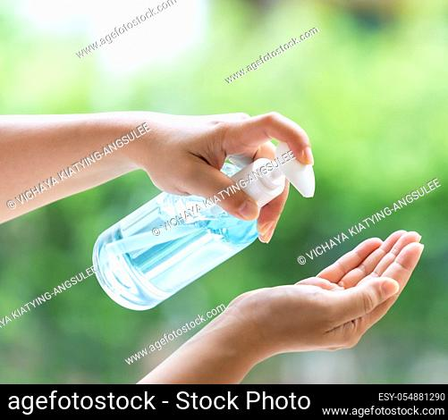 close-up cleaning hand using alocohol gel hand sanitizer waterless in pump bottle, disinfection for safety prevent and protect from infection of virus and germ...