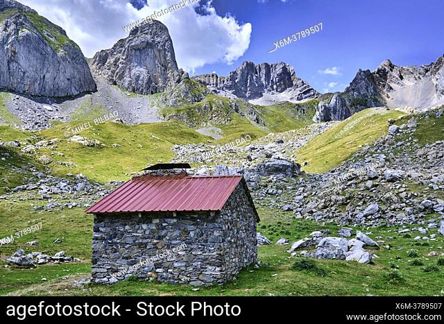 Mountains landscape and a cabin in Ibon de Acherito route. Valles Occidentales Natural Park. Hecho valley. Pyrenees mountain Range, Huesca, Aragon, Spain