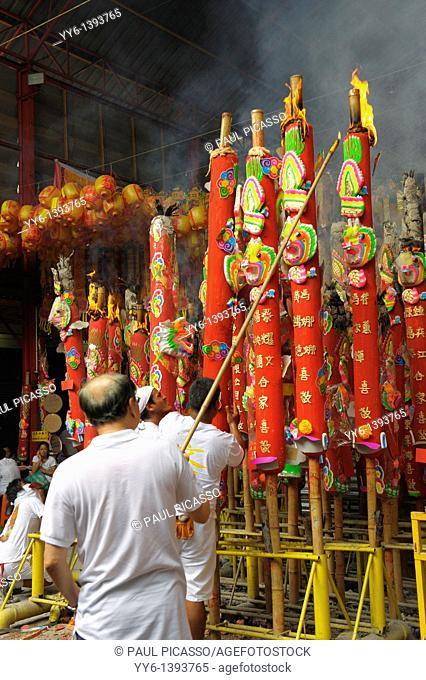 lighting candles , making merit , Vegetarian festival at San Jao Sieng Kong shrine , wat sung heng yee, Chinatown , Bangkok, thailand