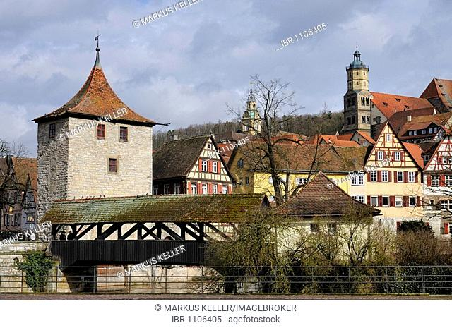 View towards the historical town centre of Schwaebisch Hall with the Sulfer Steg bridge crossing over the Kocher River, Sulfer Tower, Kocherfront facade and St