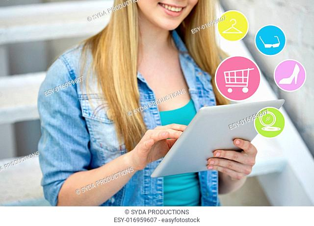 people, technology and online shopping concept - close up of female with tablet pc computer and internet icons on stairs