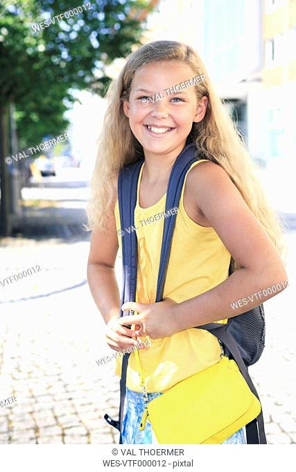 Germany, Thuringia, Portrait of girl going to school, smiling