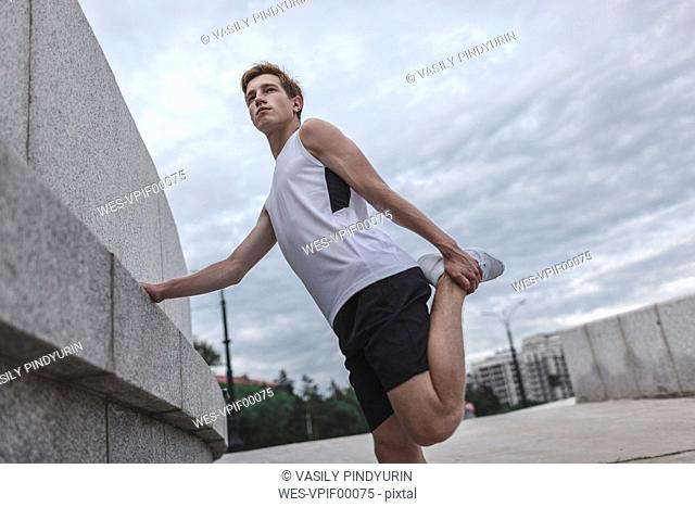 Young athlete stretching outdoors