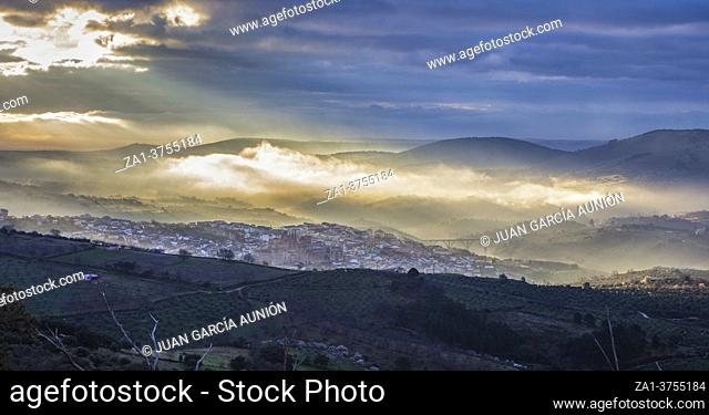 Stunning overview of Guadalupe village during a foggy sunrise, Caceres, Spain
