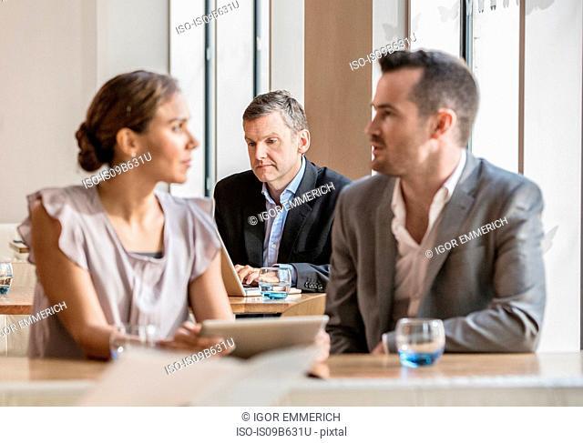Businessmen and businesswoman working