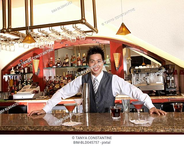Asian male bartender and cocktails