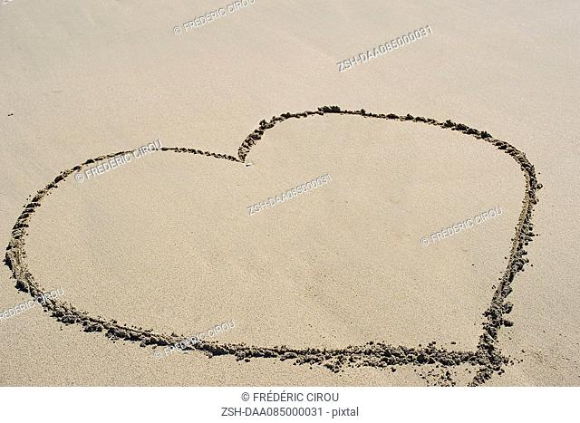 Heart drawn in sand on beach