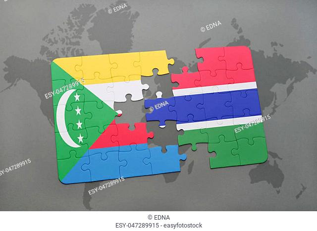 puzzle with the national flag of comoros and gambia on a world map background. 3D illustration