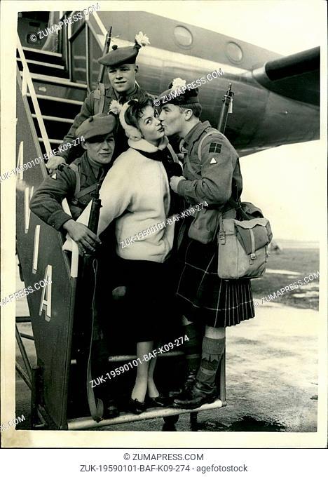 Jan. 01, 1959 - Highland Light Infantry Leaves For Cyprus. Farewell Kiss From Janette Scott. Men of the Ist. Battalion Highland Light Infantry left Blackbushe...