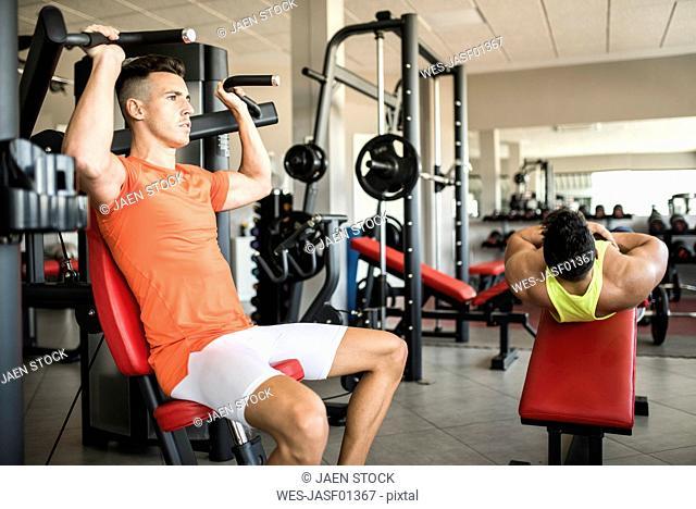 Two men exercising in gym