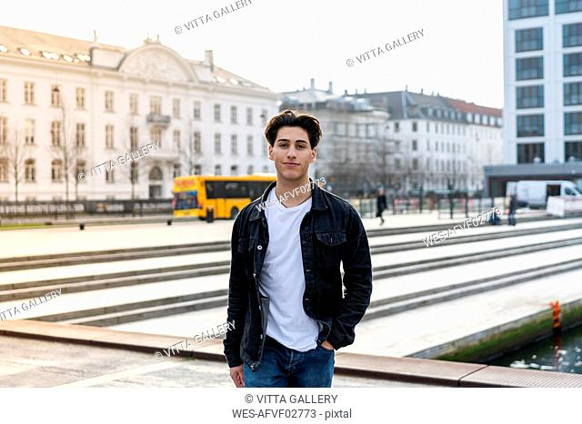 Denmark, Copenhagen, portrait of a confident young man in the city