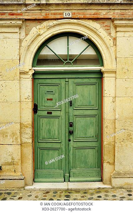 green door, Place de la Halle, Auvillar, Tarn-et-Garonne Department, Midi-Pyrenees, France