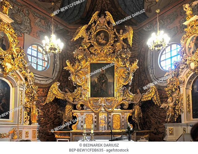 Altar in larch-wood Church of Saint Nicholas in Gasawa, village in Kuyavian-Pomeranian voivodeship. Poland. The Church was built in XVII century