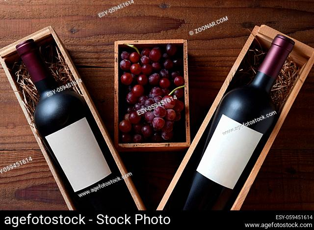 Wine Still Life: Two wood wine boxes with a bottle with blank labels. Between the boxes is a small box filled with grapes
