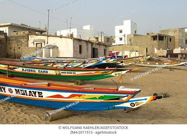 SENEGAL, NEAR DAKAR, SMALL FISHING VILLAGE, BEACH, COLORFUL FISHING BOATS