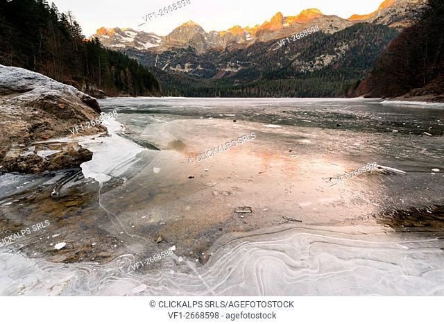 Dawn Tovels lake on a cold winter day, Natural Park Adamello Brenta, Non valley, Trentino Alto Adige, Italy