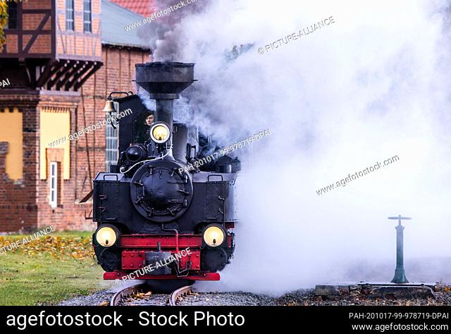 17 October 2020, Mecklenburg-Western Pomerania, Klütz: A 102-year-old brigade locomotive pulls a passenger train from the station onto the line of the...