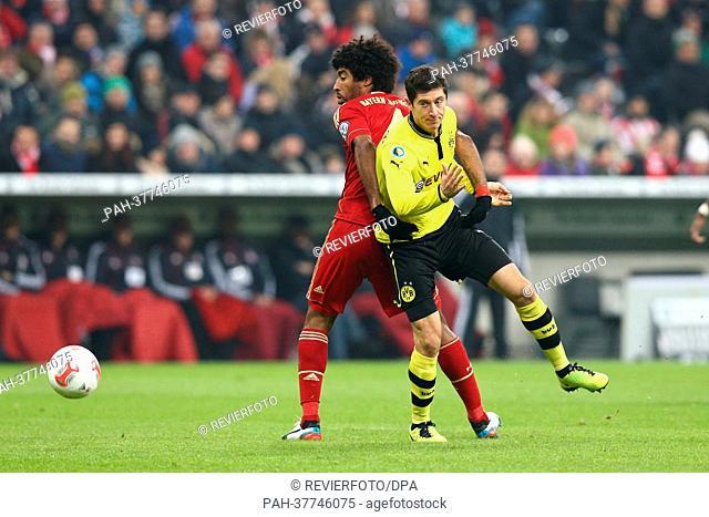 Dortmund's Robert Lewandowski (R) vies for the ball with Munich's Dante during the DFB Cup quarter final match between FC Bayern Munich and Borussia Dortmund at...