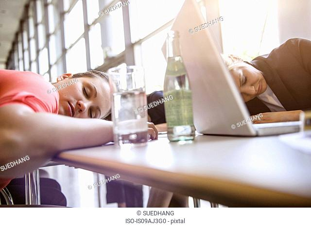 Businesswomen exhausted at brainstorm meeting
