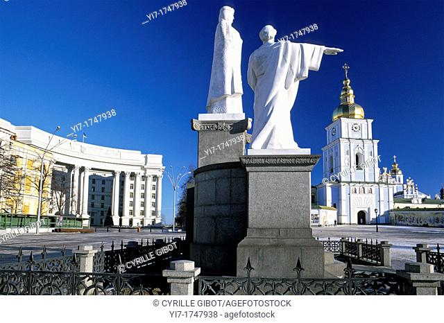 Kiev, Ukraine  The statues of Saint Cyril and Methodius on St Michael Square, with the entrance to St Michael golden domed monastery and the Ukrainian ministry...