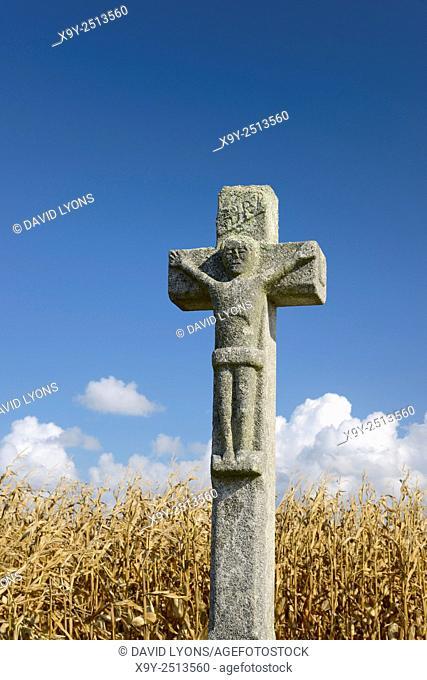 Calvary crucifix stone Christian monument Calvaire de Crucuno in fields outside village of Crucuno, Morbihan, Brittany, France