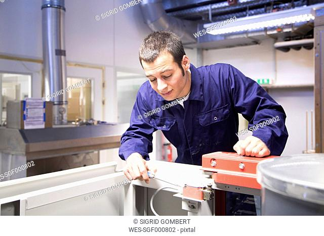 Technician working in a technical room