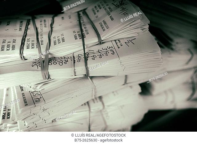Tickets from a cash register packaged and stored in a closet. London, England, UK, europe