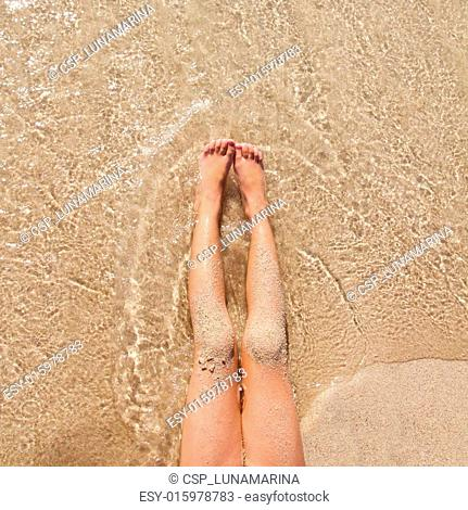 Female Resting In The Sandy Floor Stock Photos And Images