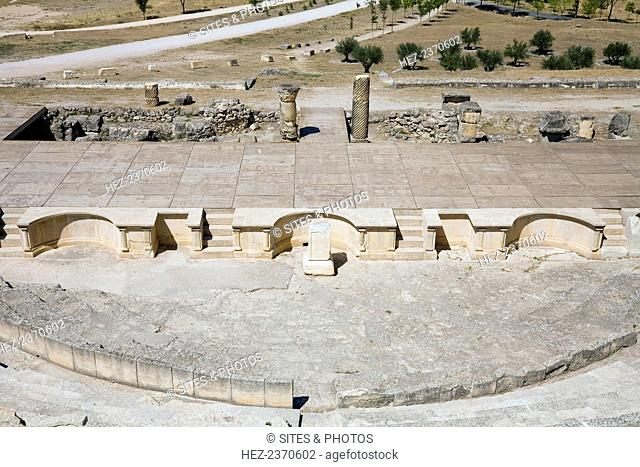 The theatre in Segobriga, Spain, 2007. Construction of the theatre probably began during the reign of the Emperor Tiberius; it was completed in the Flavian...