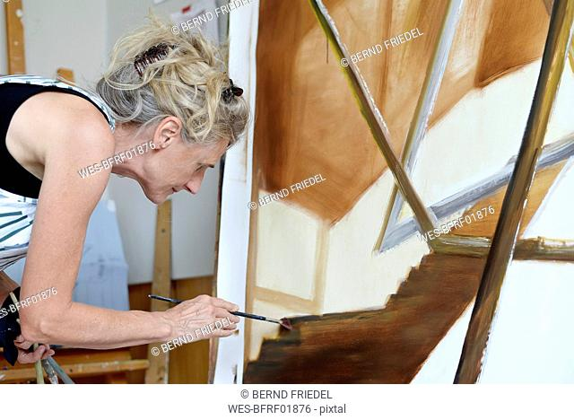 Female painter in her atelier, painting