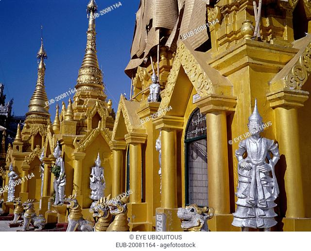 Shwedagon Paya. Golden shrines and statues in temple complex