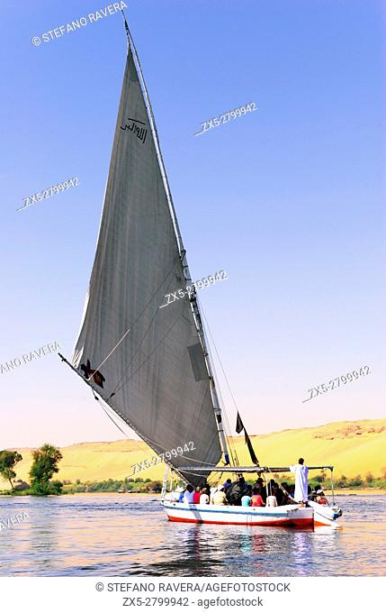 Felucca with tourists sailing in the Nile - Aswan, Upper Egypt