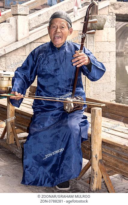 Chinaman Playing Erhu Xitang China