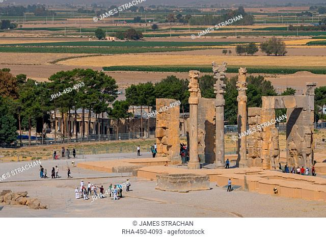 Overview of All Nations Gate and tourist groups setting off on their tours, Persepolis, UNESCO World Heritage Site, Iran, Middle East