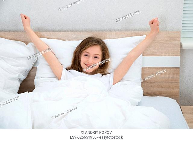 Girl Smiling While Waking Up From Bed