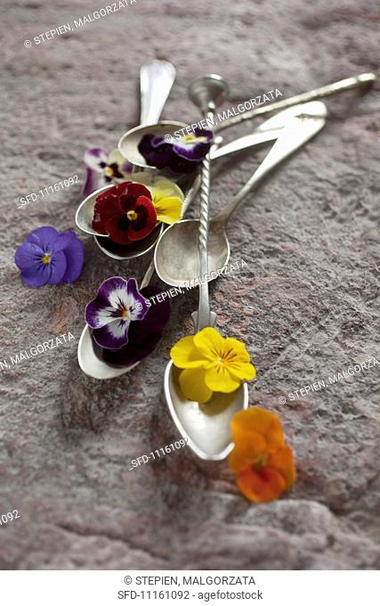 Antique spoons decorated with flowers