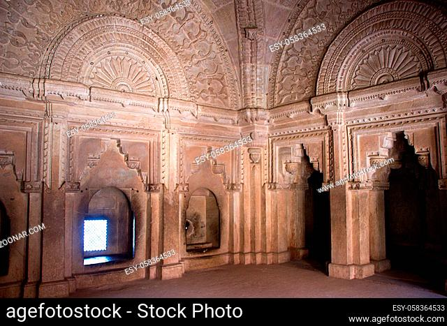 View of fine carving on arches and upper wall of hall at Gwalior Fort in Gwalior, Madhya Pradesh, India, Asia