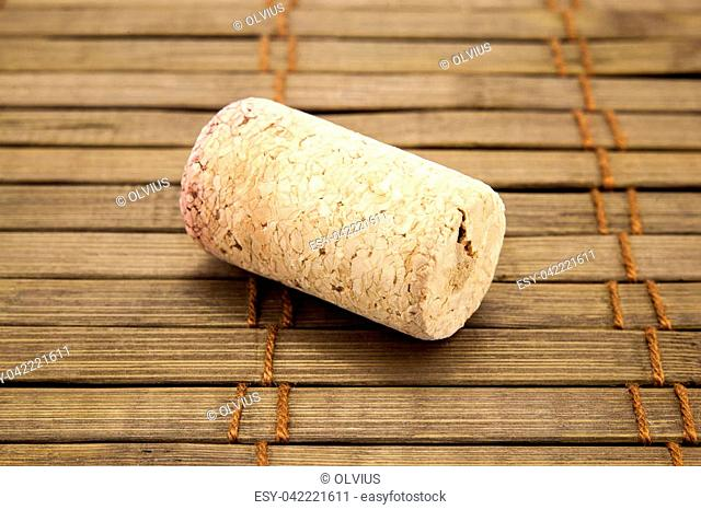 Close-up of vintage wine cork on old wooden surface