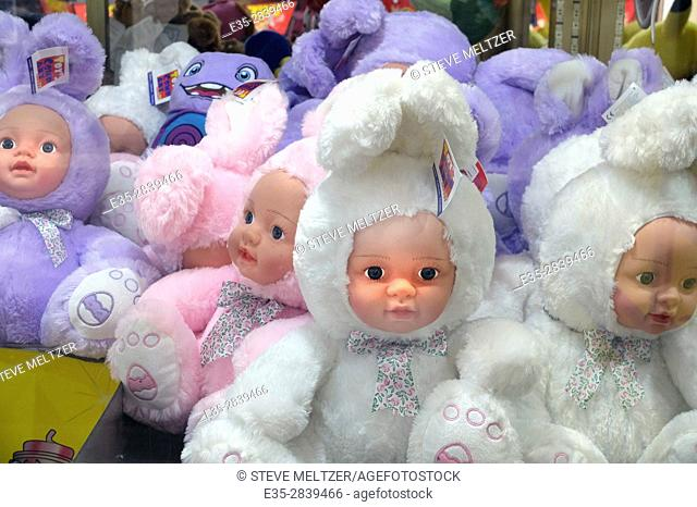 Strange dolls are offered as prizes at an amusement park